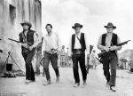 Four guys with trench guns walking into a small Mexican village never ends well.